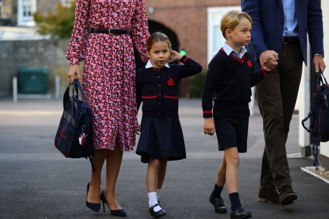 Princess Charlotte twirls her hair as she walks in with her family