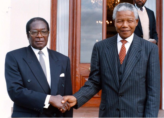 Robert Mugabe and Nelson Mandela Robert Mugabe on a state visit to South Africa in the 1990s