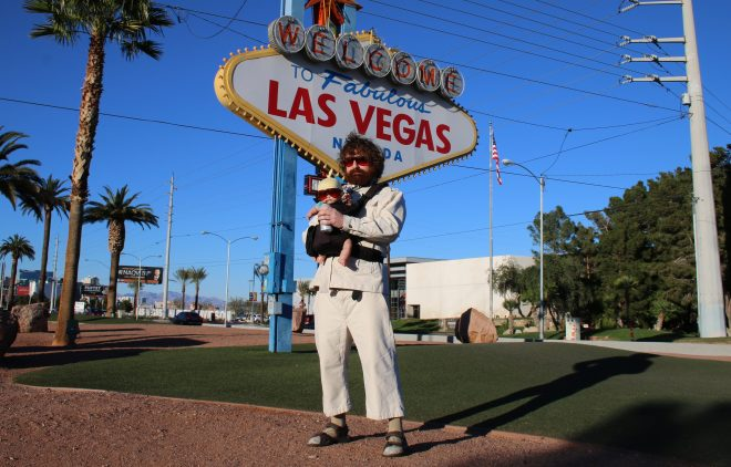 Thaddeus Kalinoski poses as Zach Galifianakis' character Alan Garnerin in his Hangover costume complete with robotic baby in Las Vegas