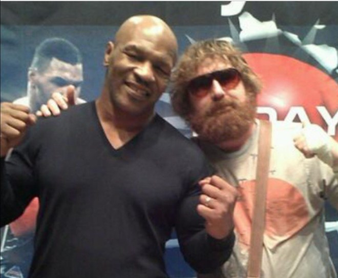 The ex caterer poses with Mike Tyson during a night out in Vegas