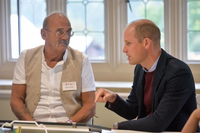 The Duke of Cambridge speaks with Richard Baldwin in an art therapy session