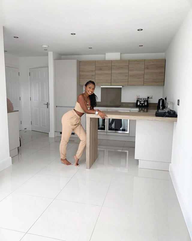 Jourdan Raine poses in the couple's flash new kitchen