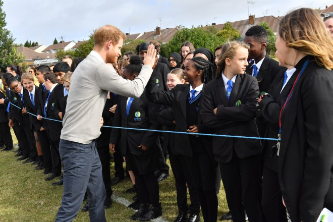 Hundreds of school kids greeted the 34-year-old royal
