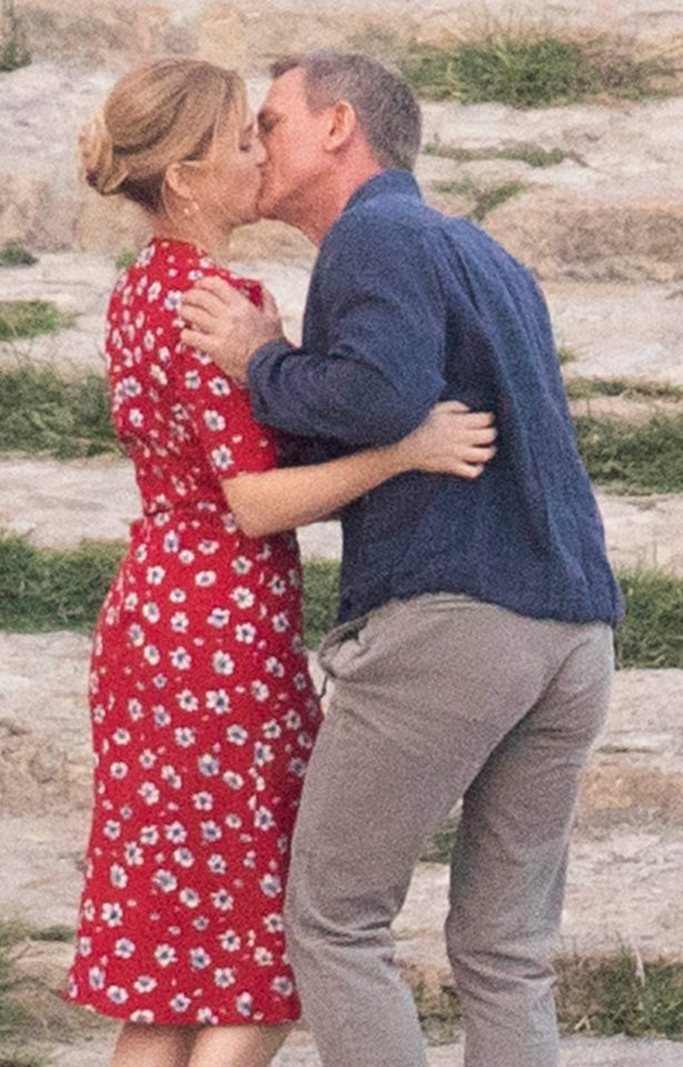 Daniel Craig planted a tame kiss on Lea Seydoux as they filmed scenes for the latest Bond film