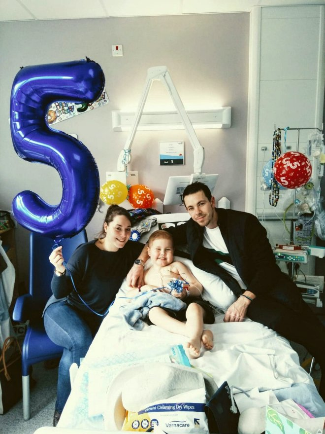 Oscar with his mum Olivia, and dad at Birmingham Children's Hospital