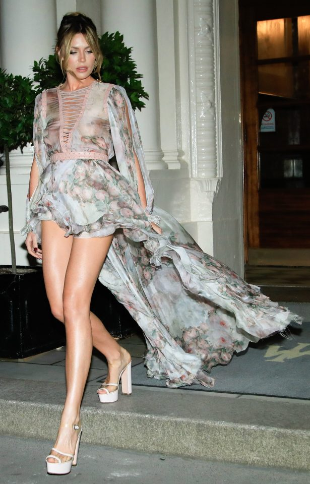 Her floral dress perfectly floated behind her as she showed off her supermodel legs