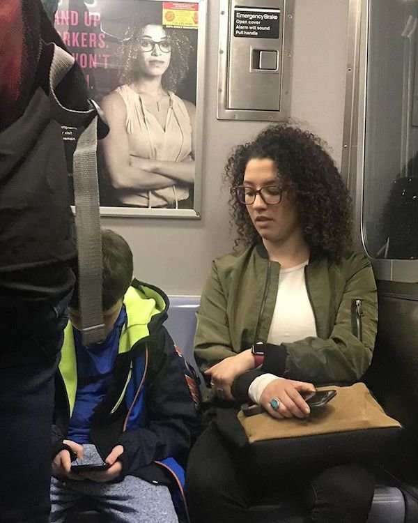 This woman did not notice her doppelganger was right behind her