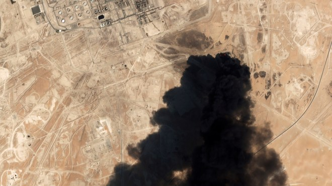 A satellite image shows thick black smoke rising from Saudi Aramco's Abqaiq oil processing facility in Buqyaq, Saudi Arabia