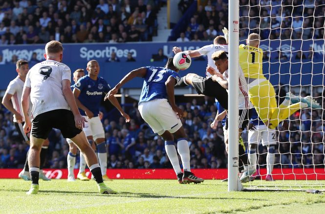 The ball flies off Yerry Mina into his own net to gift the Blades the lead