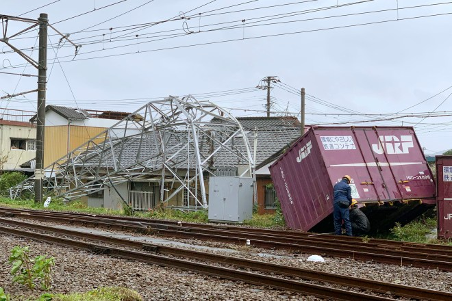 A cargo container and a steel tower are damaged by winds after Typhoon Tapah hit Nobeoka