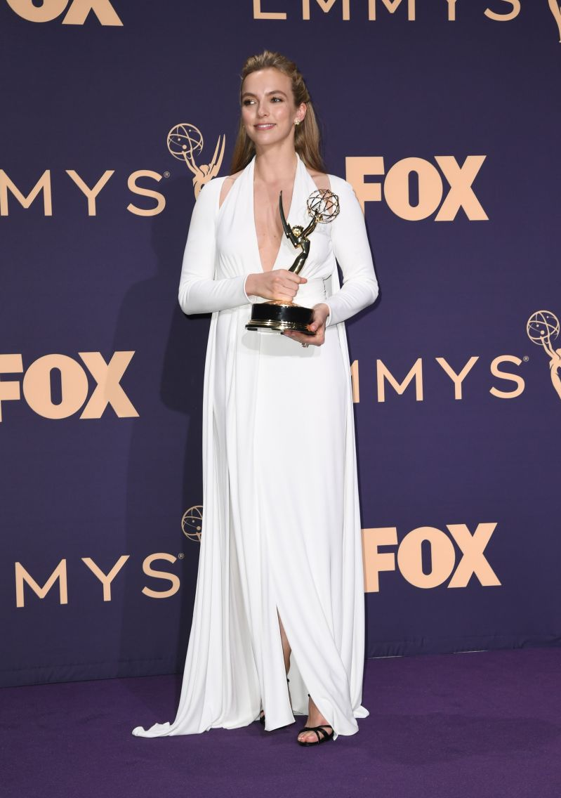 Emmys winner Jodie Comer shows off incredible figure in plunging gown at after party as she stuns fans with her Liverpool accent