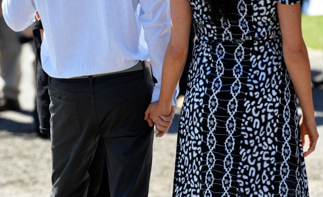 The couple held hands as they appeared to be relaxed and enjoying themselves