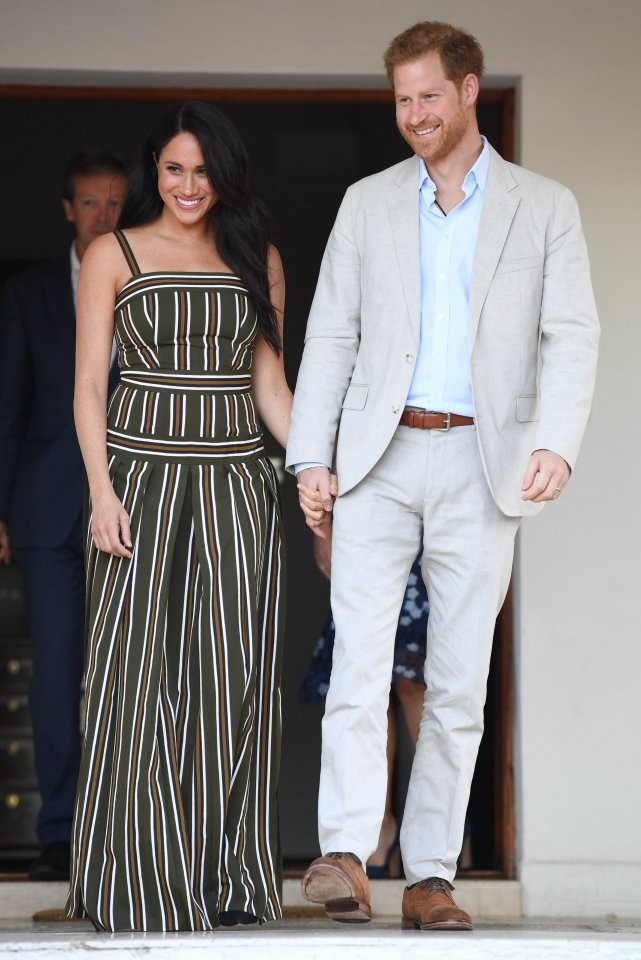 Meghan and Harry were hand in hand as they arrived for this evening's event