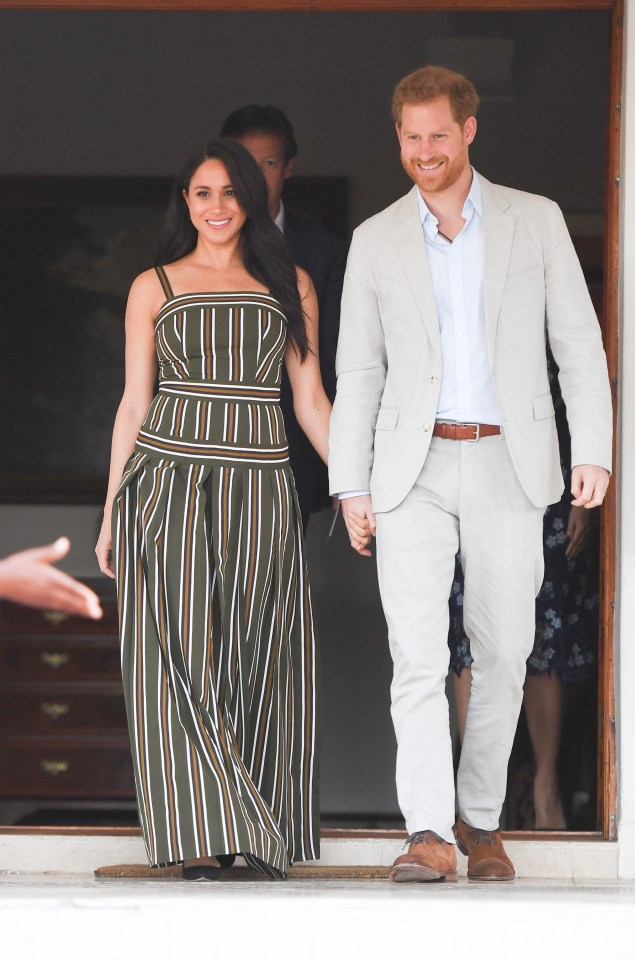 The couple hold hands at one of the official events in South Africa yesterday