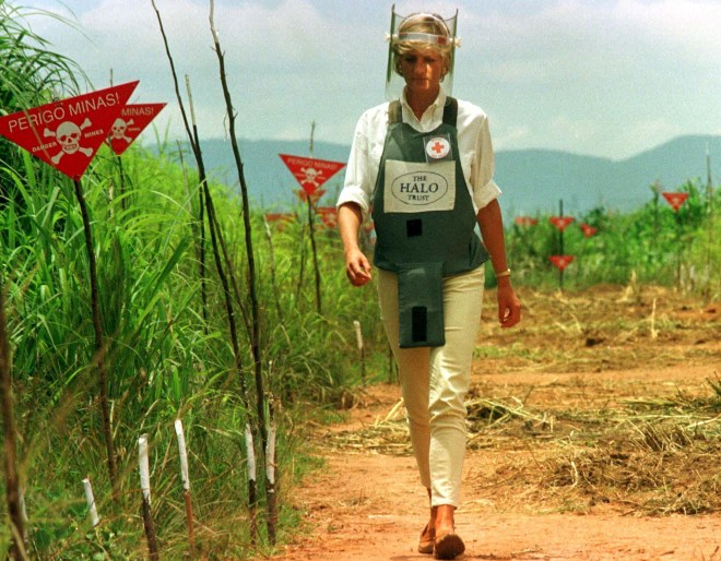 Princess Diana walks through a cleared lane in the middle of a landmine field