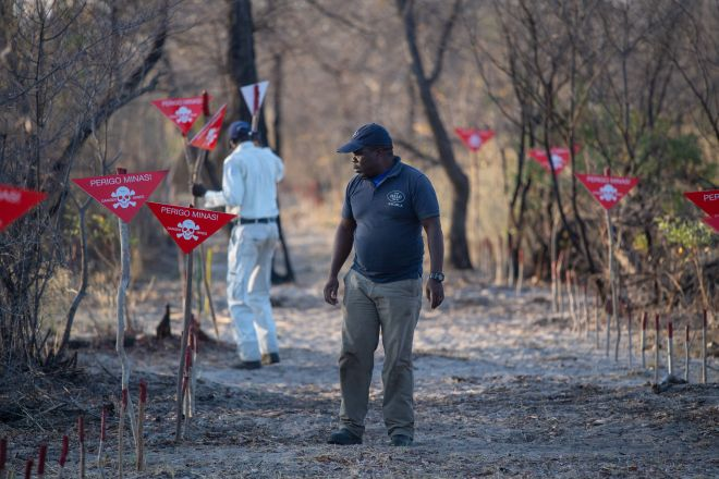 Workers prepare ahead of the Duke of Sussex's visit to the Halo Trust Minefield outside Dirico, Angola
