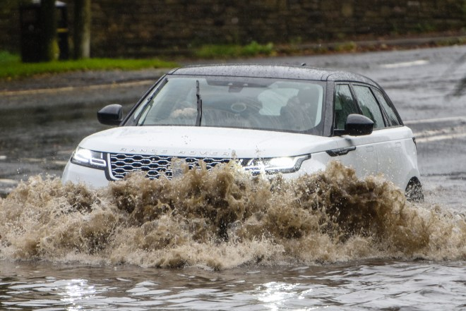 Intense downpours in Horwich, Greater Manchester, with drivers battling inches of floodwater