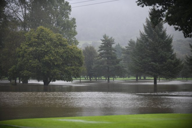 Flood water covers the fairways and greens of the Mond Valley golf course in Clydach near Swansea
