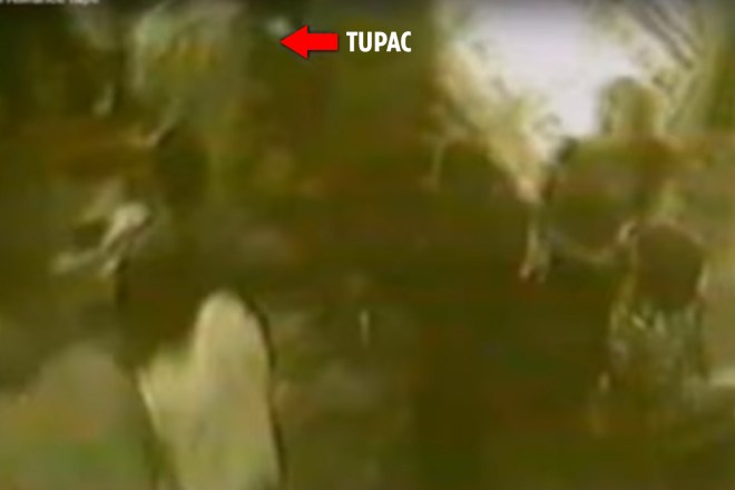 The bizarre and blurry video claims to show Tupac disappearing into a crowd