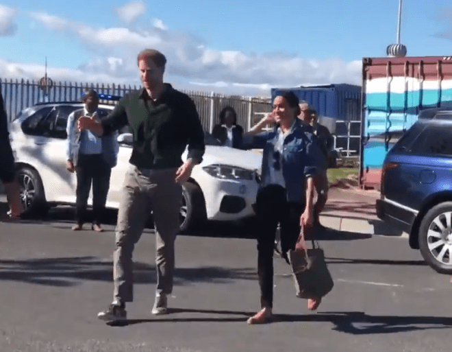 Meghan Markle and Prince Harry beam as they arrive for the second day of their tour