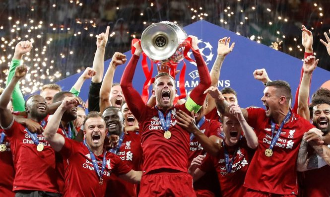 Jordan Henderson helps Liverpool win the Champions League in June this year - and games before the final could also be shown on terrestrial TV again from 2021