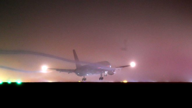 A plan tries to land at Bradford Airport in the middle of Storm Lorenzo last night