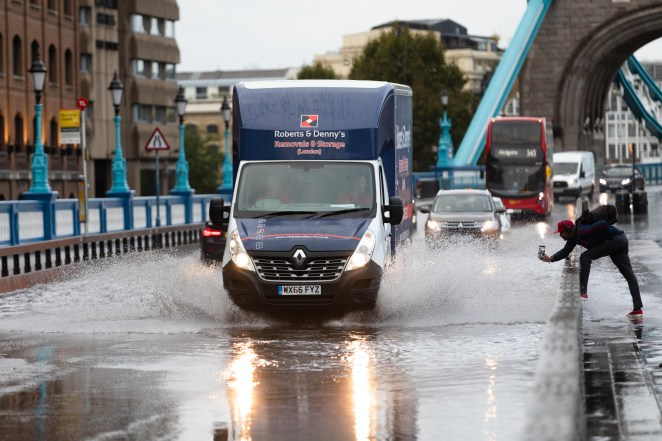 Torrential rain causes problems for drivers on Tower Bridge