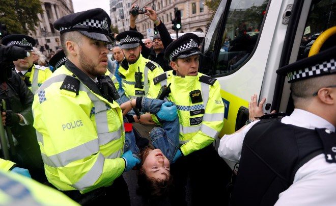 One protester is carried away by police after they were taken off the scaffolding