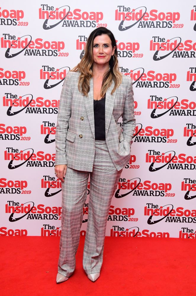 Dawn Steele looked sharp in a checked suit