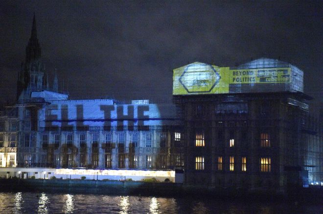 Environmental activists projected this image on the Houses of Parliament over night