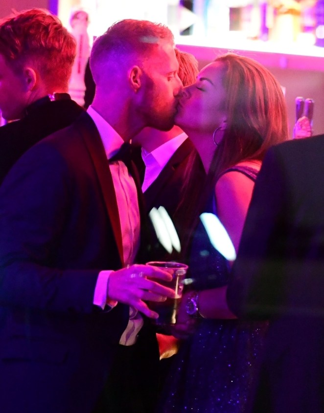 Pictures taken at the awards bash show the couple looking loved-up