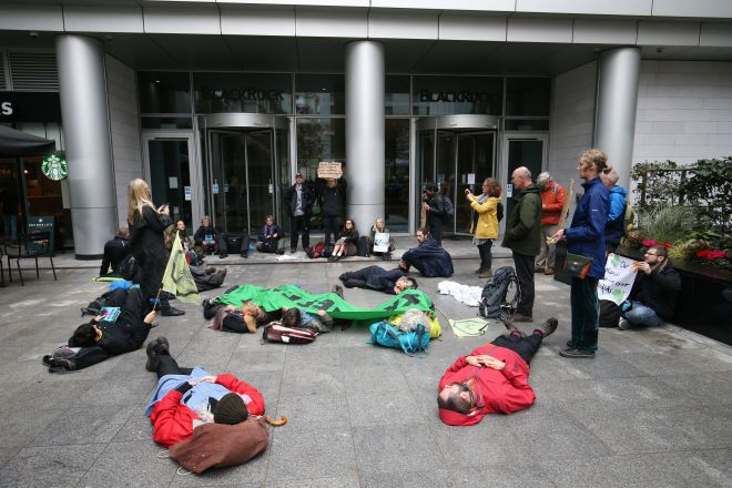 Protesters demonstrate outside the BlackRock headquarters in Throgmorton Avenue, Central London
