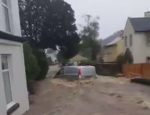 This is the dramatic moment a van gets caught up in severe flooding in Laxey on the Isle of Man