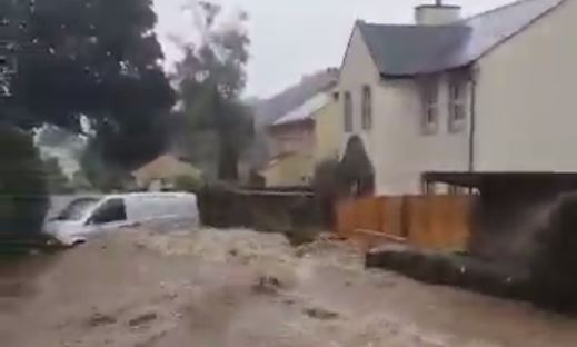 This van washed away amid floods on the Isle of Man this morning