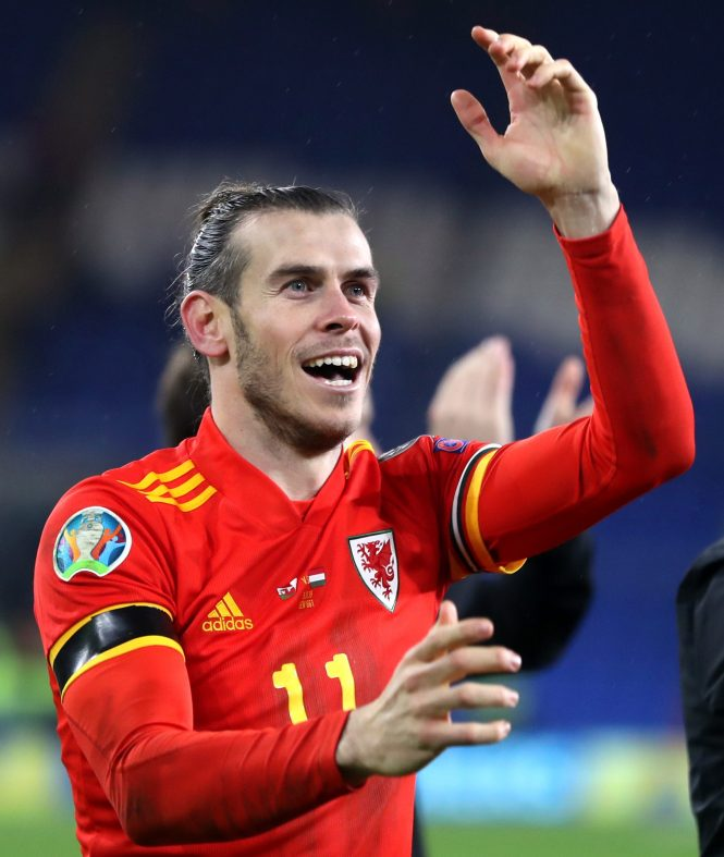 Gareth Bale shows his deligh as Wales seal their sport at the Euros next summer