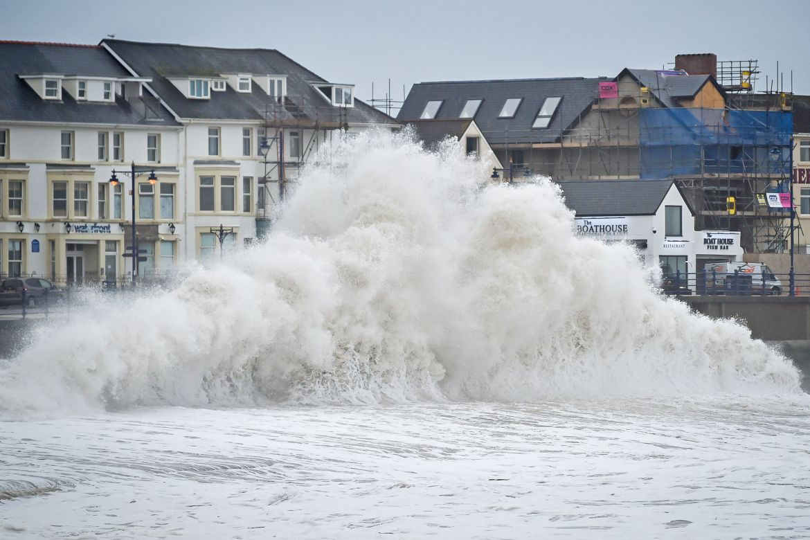 UK weather forecast: huge waves hit the sea wall in Porthcawl on Tuesday