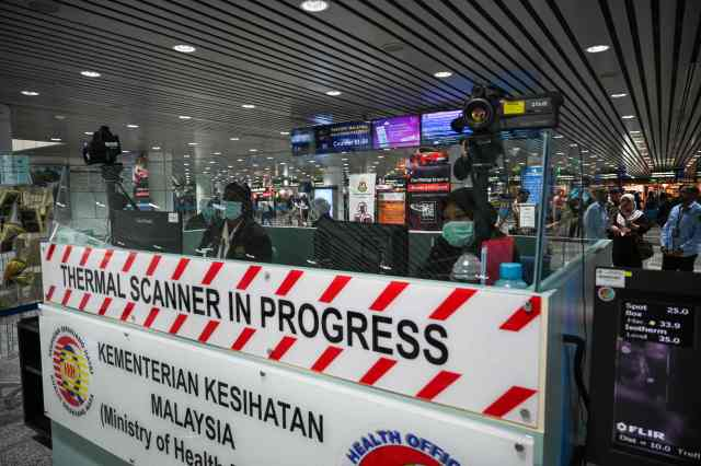 Signs have been erected at Kuala Lumpur International Airport warning passengers they will be screened