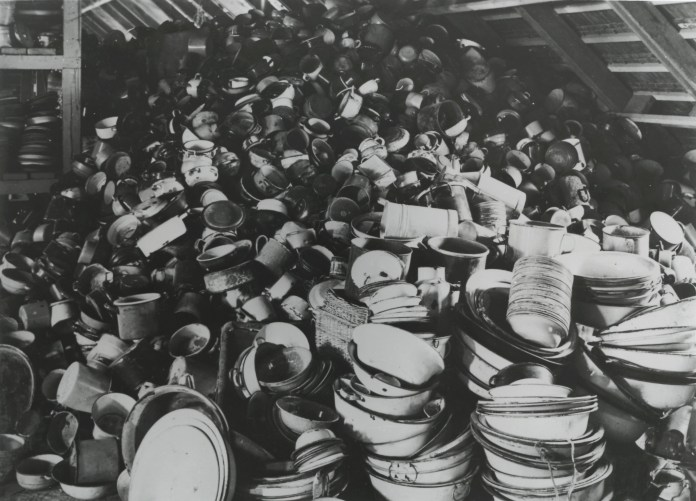 Piles of pans and pots brought by people with no idea about what was about to happen to them