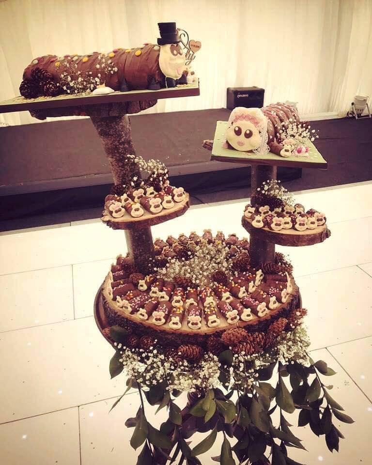 The couple opted for two of the £50 cakes and added three more rows of mini Connie the Caterpillar rolls