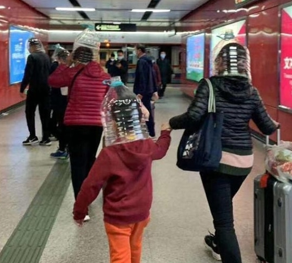 A mother and child were spotted with plastic bottles on their head
