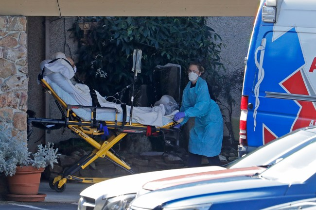 A patient is loaded into an ambulance at the Life Care Center in Kirkland, Washington