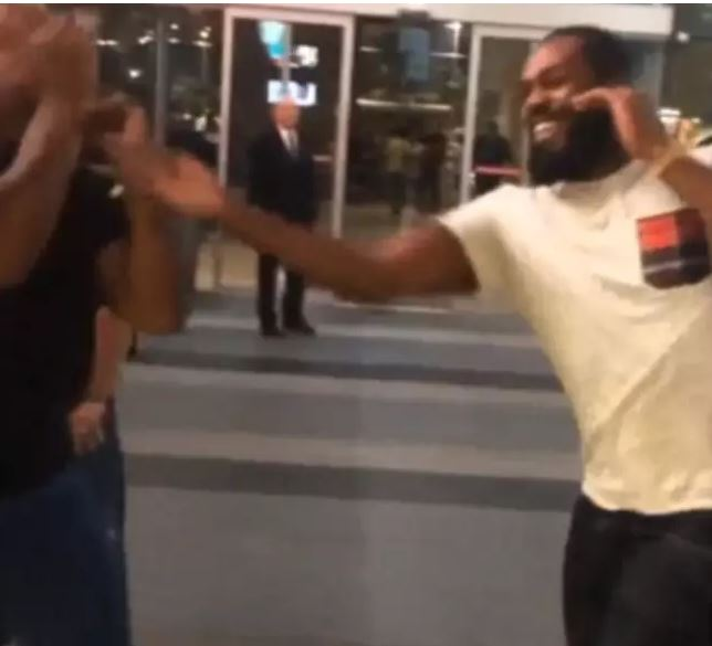 Jon Jones lays a right slap on Mike Tyson in a joke street fight