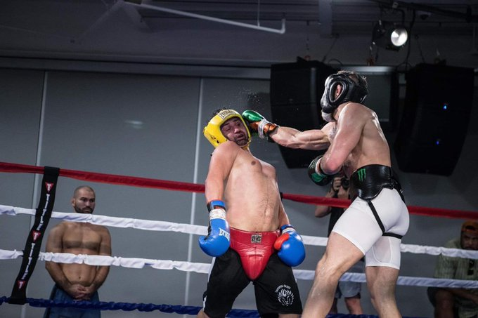 Artem Lobov, bottom left, witnessed the spars and defeated Malignaggi in an unarmed fight
