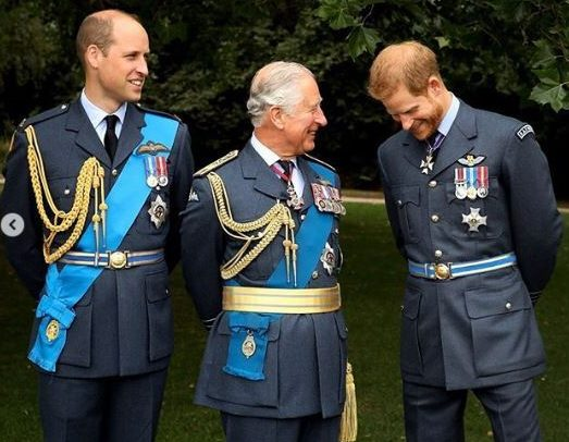 A snapshot of Harry, William and their father occupies a prominent place on the coat