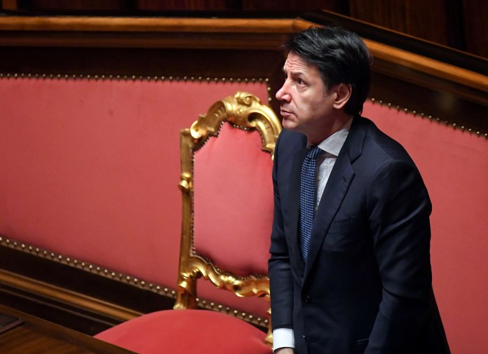 Italian Prime Minister Giuseppe Conte stands during a session on COVID-19 in the upper house of Parliament in Rome