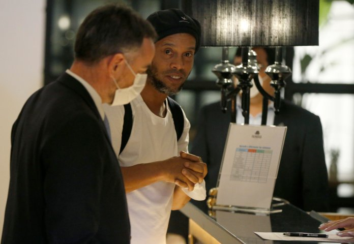 Brazilian legend seen checking in luxury hotel
