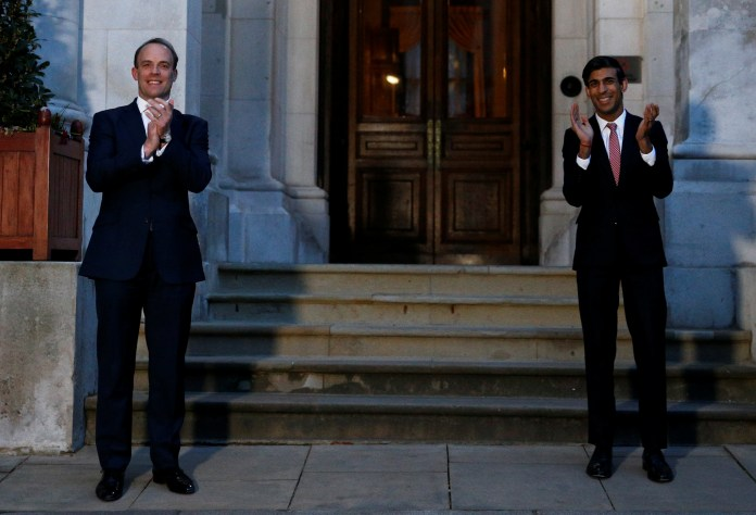 Dominic Raab and Rishi Sunak stood outside to cheer NHS workers tonight