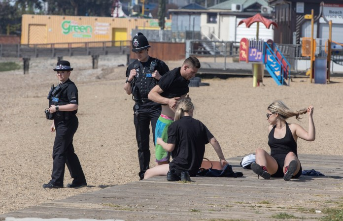 Police were observed cleaning the bathers' beach at Southend on Sea