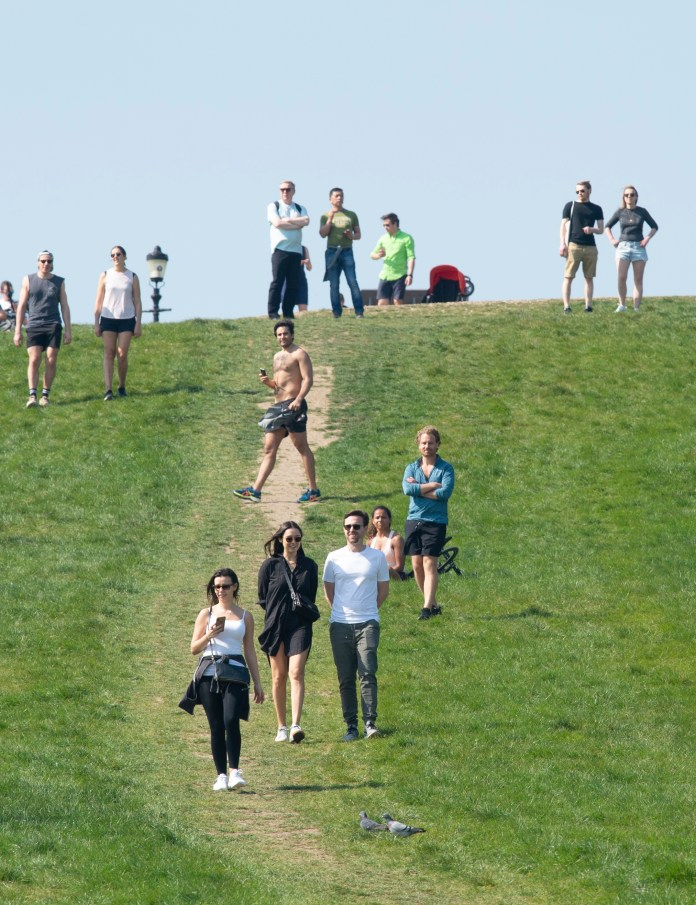 Members of the public ignored government social distancing rules for sunbathing and picnicking on Primrose Hill in north London