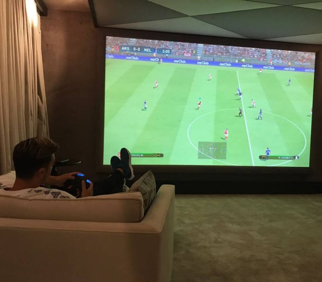 The home cinema doubles as Ozil's games room